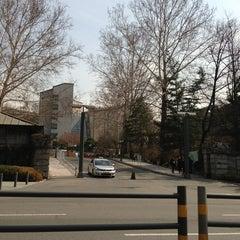 Photo taken at 이화여자대학교 후문 (Ewha Womans University Back Gate) by J. L. on 3/26/2013