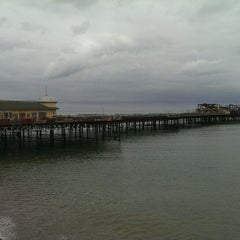 Photo taken at Hastings Pier by Jānis S. on 6/16/2014