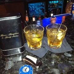 Photo taken at LIT Premium Cigar Lounge by Dennis P. on 10/19/2012