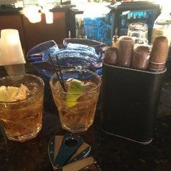 Photo taken at LIT Premium Cigar Lounge by Dennis P. on 11/2/2012