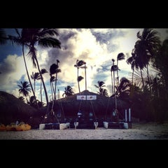 Photo taken at Los Corales Beach by Julia G. on 8/27/2014