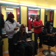 Photo taken at De Lux Natural Hair Gallery by Robert M. on 12/18/2012