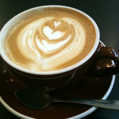 Photo taken at Comet Coffee by Suhkyung K. on 7/1/2013