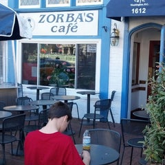 Photo taken at Zorba's Cafe by Andre C. on 4/5/2013