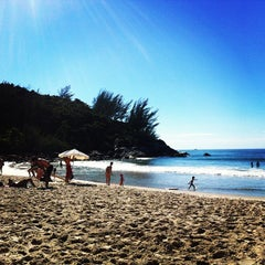 Photo taken at Praia da Ferrugem by Guilherme R. on 2/14/2013