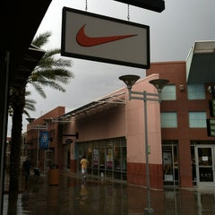 Photo taken at Nike Factory Store by Michael B. on 8/19/2013