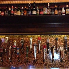 Photo taken at Flying Saucer Draught Emporium by Christopher G. on 3/2/2014