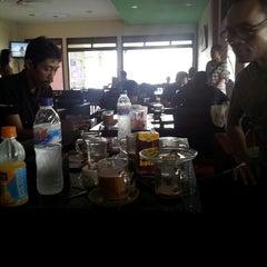 Photo taken at Mazzagena Coffee & Resto by Yuzhuf J. on 1/25/2014