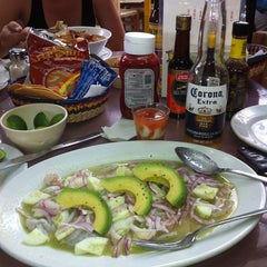 Photo taken at 8 Tostadas by Carlos P. on 6/22/2013