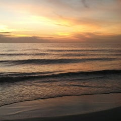 Photo taken at Tiki Gardens Beach Spot by John H. on 12/4/2013