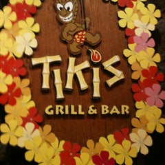 Photo taken at Tiki's Grill & Bar by Isabelle on 7/25/2012