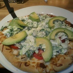Photo taken at California Pizza Kitchen by Sheena I. on 5/12/2012