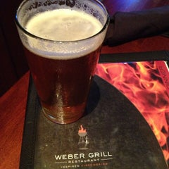 Photo taken at Weber Grill Restaurant by Jude D. on 6/26/2013