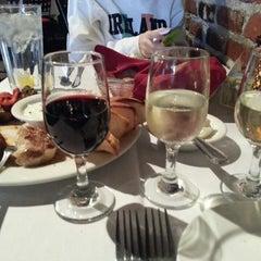 Photo taken at Grape Street Cafe by Ricky M. on 12/19/2013