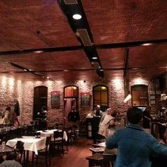 Photo taken at Mompou Tapas Bar & Lounge by Tanzer V. on 11/20/2012