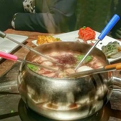 Photo taken at The Melting Pot by Eric C. on 10/24/2014