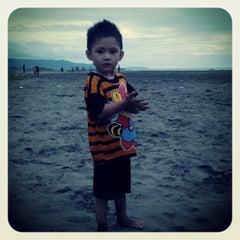 Photo taken at Pantai ombak 7 by Aji I. on 12/31/2013