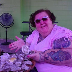 Photo taken at Magnolia's Oyster Bar by Dana P. on 5/10/2013