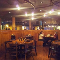 Photo taken at Outback Steakhouse by Alex G. on 9/28/2012