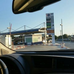 Photo taken at Gasolinera Carrefour Planet by Oli R. on 9/19/2015
