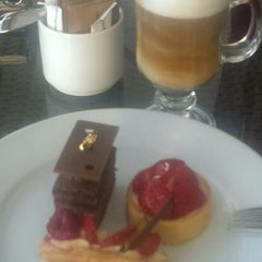 Photo taken at Cafe Swiss by Barış T. on 6/24/2014