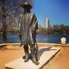 Photo taken at Stevie Ray Vaughan Statue by Lee S. on 3/16/2013