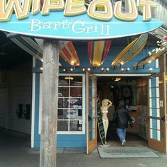 Photo taken at Wipeout Bar & Grill by Andrew S. on 3/7/2013