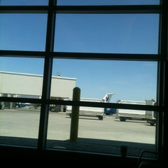 Photo taken at Arrival Lounge by Eric N. on 5/20/2012