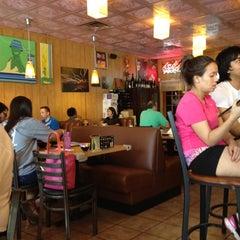 Photo taken at Oishii Japanese Restaurant & Sushi Bar by Gil G. on 6/9/2012