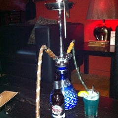 Photo taken at Karma Hookah and Cigar Lounge by Anthony C. on 2/19/2012