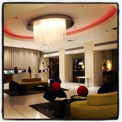 Photo taken at Radisson Blu Gautrain Hotel by Neil S. on 4/12/2012