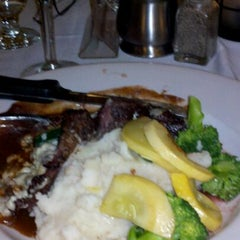 Photo taken at Barnaby's Steakhouse by Dan N. on 3/4/2012