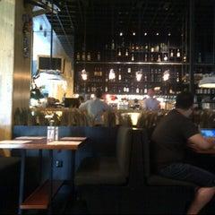 Photo taken at MUNCHIES Restaurant & Bar by Ester G. on 12/30/2012