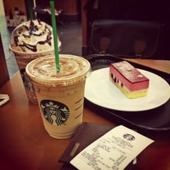 Photo taken at Starbucks (สตาร์บัคส์) by Kot S. on 1/1/2013