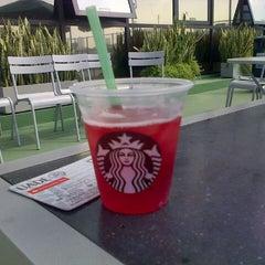 Photo taken at Starbucks by Victoria U. on 9/19/2014