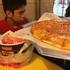 Photo taken at Yellow Cab Pizza Co. by Pam C. on 4/25/2014