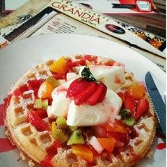 Photo taken at Grandia Resto Café & Pastry by gungsye p. on 2/21/2015