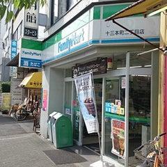 Photo taken at ファミリーマート十三本町二丁目店 by つじやん 全. on 5/11/2015