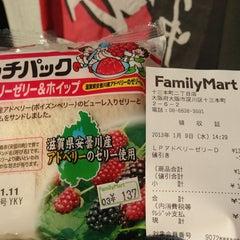 Photo taken at ファミリーマート十三本町二丁目店 by つじやん 全. on 1/9/2013