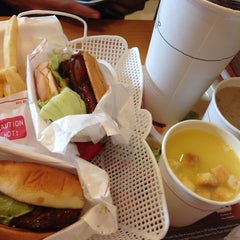 Photo taken at MOS Burger by Cassandra C. on 7/15/2014
