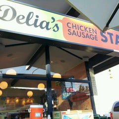 Photo taken at Delia's Chicken Sausage Stand by Ernie D. on 10/3/2012