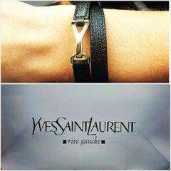 Photo taken at Yves Saint Laurent by Stanley A. on 7/6/2013