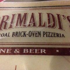 Photo taken at Grimaldi's Coal Brick-Oven Pizzeria by John C. on 2/27/2013