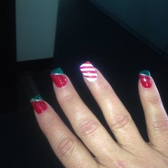 Photo taken at Plaza Nails by Lucy C. on 12/19/2013