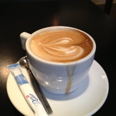 Photo taken at Caffé Nero by Henrik T. on 4/22/2013