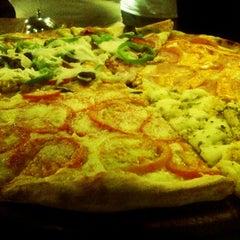 Photo taken at Pomodori Pizza by Thiago F. on 9/29/2012