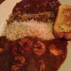 Photo taken at Boudreaux's Cajun Kitchen by Allen A. on 3/25/2013