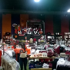 Photo taken at Rivals - Store Divided by Curtiss G. on 6/25/2014