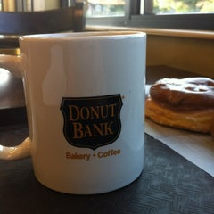 Photo taken at Donut Bank Bakery & Coffee Shop by Doug B. on 5/10/2012