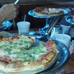 Photo taken at Chesapeake Pizza by Angela K. on 4/19/2012